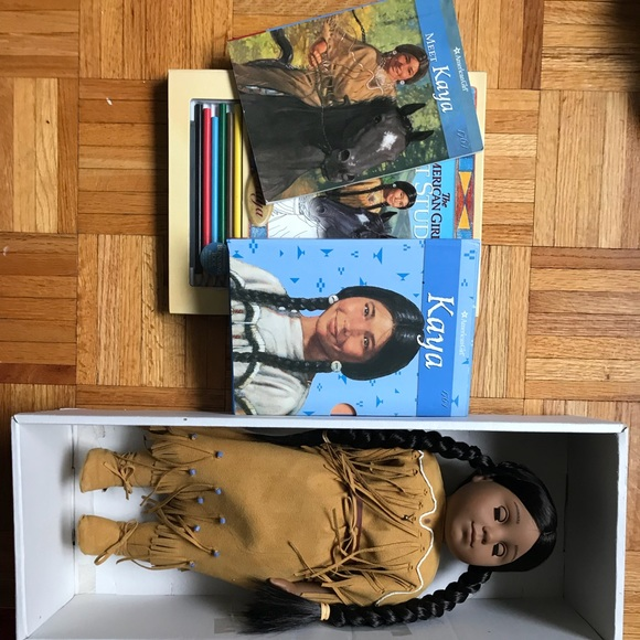 American girl doll, with a coloring book+ books.